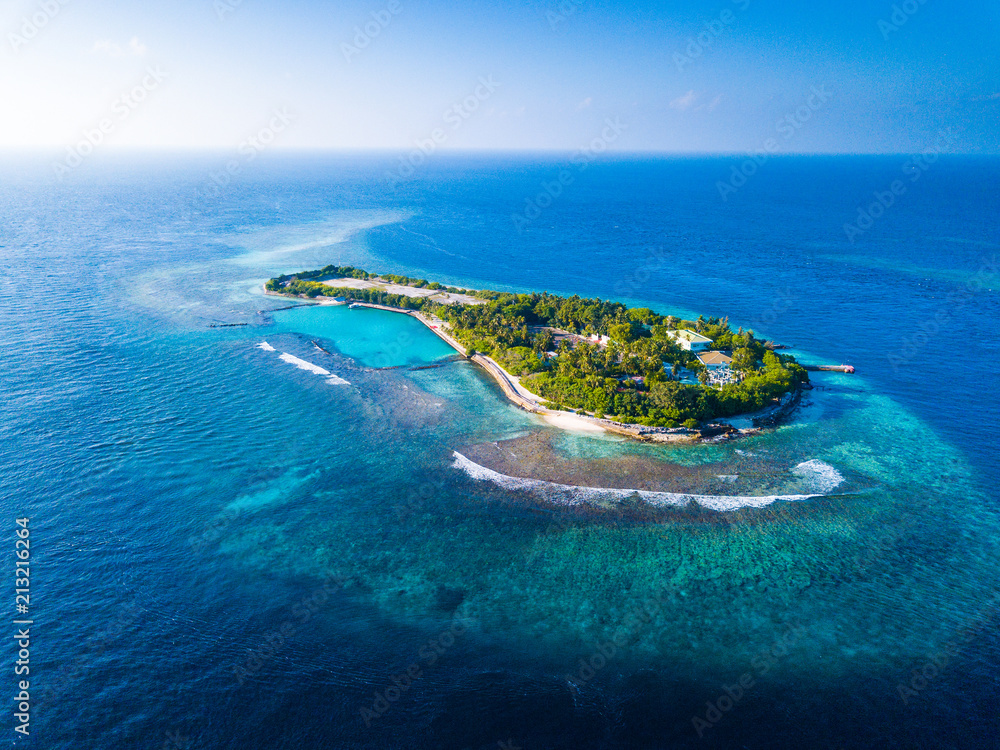 Fototapeta Aerial view of the tropical island in the middle of the Indian Ocean. Maldives