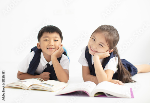 Fotografie, Obraz  happy little boy and girl student studying together