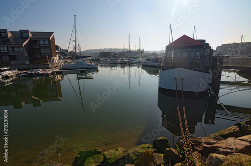 City on the water Yacht in the port of Deauville, Calvados departement in the Normandy region in France. Early morning view