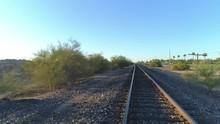 4K Dolly Pan Of Desert Train Tracks At Sunrise