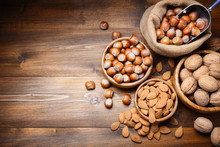 Walnuts, Hazelnuts And Almonds, Dried Fruits. Top View, Space For Text