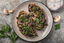 Mushrooms Garlic Toasts On Wooden Cutting Board