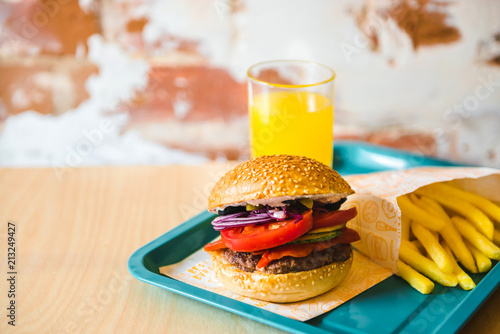 Delicious homemade burger with french fries and juice