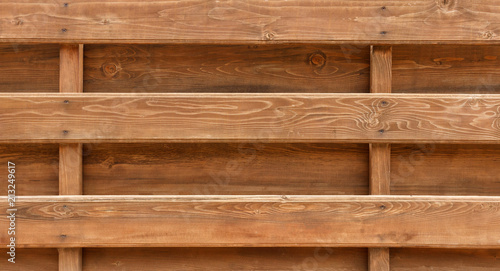 wall made of wooden logs background. wooden beams fence texture Wallpaper Mural