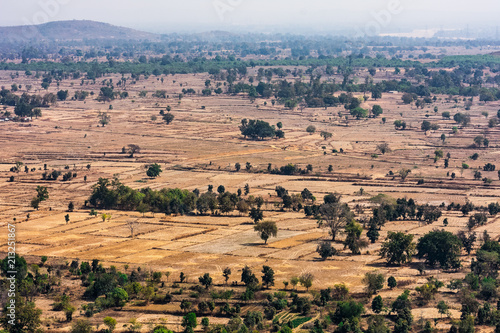 Foto op Aluminium Zalm Top view or aerial shot from top of a rocky mountain of fresh green and yellow rice fields in sunny day of summer season in rural village of india.
