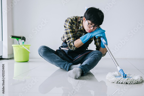 Husband Housekeeping And Cleaning Concept Tired Man In Blue Rubber Impressive Best Way To Dust Furniture Concept