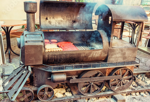 Barbecue grill with meat in shape of old steam locomotive Poster