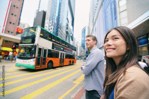 Hong Kong People walking waiting for traffic lights to cross busy road with double decker bus Tablou Canvas