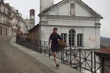 Man Running On Sidewalk By Rai...