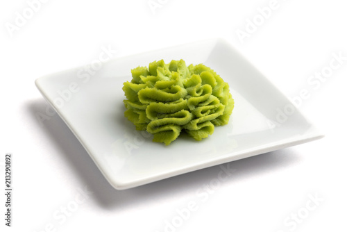 Portion of wasabi in a white gravy boat. Wallpaper Mural