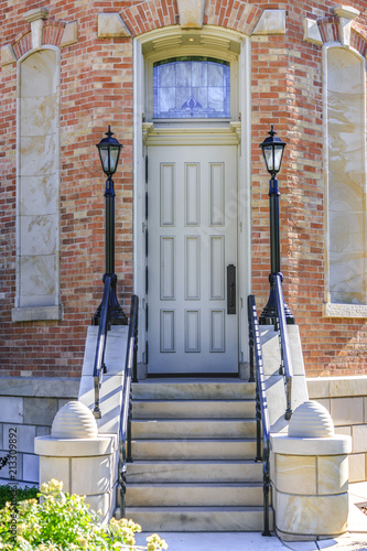 Fotografie, Obraz  Tall door with stairs leading up