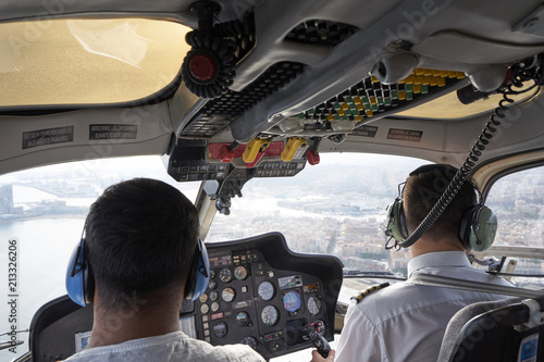 Helicopter Flight Pilots in Cockpit Canvas-taulu
