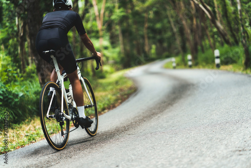 Canvas Print Cyclist He was cycling uphill climb in the woods.