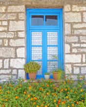 Greece, Stone Wall House Blue Window And Marigold Flowers