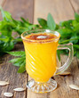 Healthy pumpkin fruit smoothie with seeds and mint leaves on table