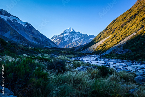 Foto op Canvas Oceanië Glacial river at sunset, Mount Cook, New Zealand