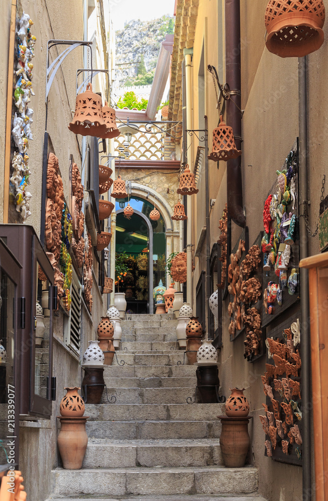 Historical center of Taormina, Sicily. Charming alley decorated with ceramics