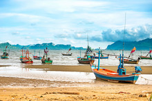 Fishing Boat On The Beach With...