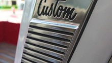 Passenger-side Close Up, Slow-motion Pan Of A Classic C10 Pickup Custom Logo And B-Pillar Trim Work From A Florida Car Show.