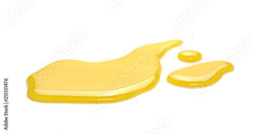 Puddle of orange juice isolated on white background, clipping path