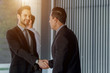 Successful Business people hand shaking after great deal.