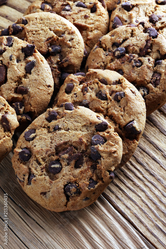 Keuken foto achterwand Koekjes Chocolate cookies on table. Chocolate chip cookies shot with chocolate