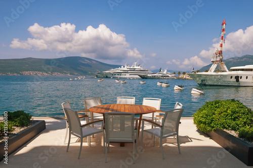 Fotobehang Cappuccino Summertime. Montenegro, Bay of Kotor. View of embankment of Tivat city and marina of Porto Montenegro
