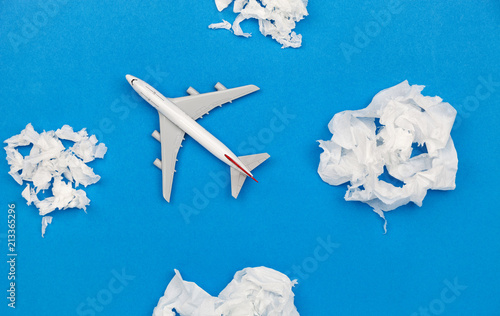 Türaufkleber Flugzeug Airplane model with paper ball Instead of white clouds on blue background ,Preparation for Traveling and tour concept.