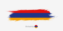 Flag Of Armenia, Grunge Abstract Brush Stroke On Gray Background.