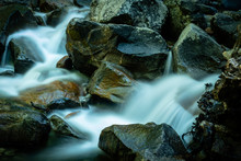Water Flowing Over Rocks In A Forest Below Bridelveil Falls In Yosemite National Park, California.