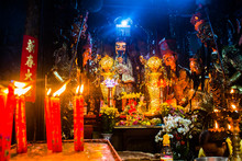 Statues And Candles At Mysteri...