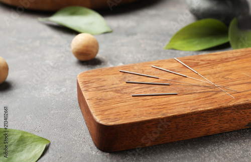Board with needles for acupuncture on dark table Canvas Print