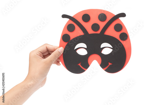 Valokuva  Hand holding Bug carnival mask isolated on white background