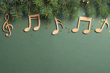 Flat Lay Composition With Fir Tree Branches And Notes On Color Background. Christmas Music Concept