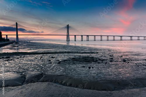 Photo  View of amazing Vasco da Gama Bridge at sunset