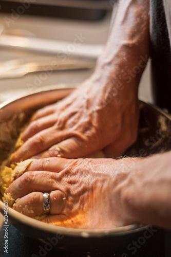 Fotografie, Obraz  A man prepares pastry in a metal bowl