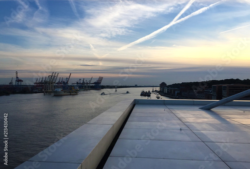 Fotografie, Tablou View from the rooftop of the dock building at sunset, Hamburg harbor