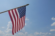 American Flag Against Blue Sky And Clouds 3