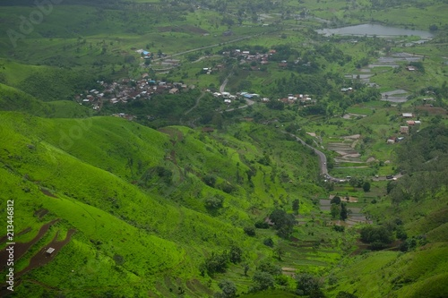 Green landscape surrounded by hills, mountains in monsoon season