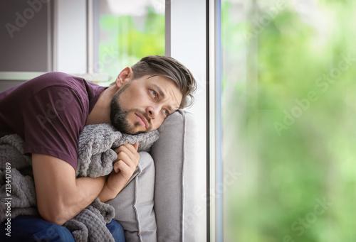 Lonely man suffering from depression at home Tapéta, Fotótapéta