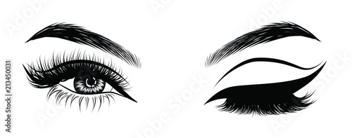 Fototapeta Sexy winking luxurious eye with perfectly shaped eyebrows and full lashes