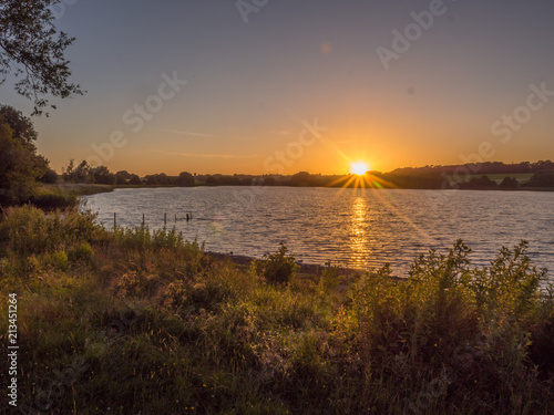 Fototapeta Beautiful summer sunset over pickmere lake, Pickmere, Cheshire, UK