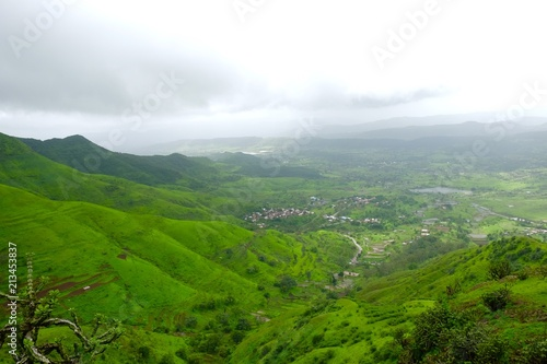 Foto op Aluminium Wit Green landscape surrounded by hills, mountains in monsoon season
