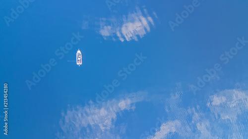 Foto op Canvas Luchtfoto Boat cruising blue Mediterranean sea aerial view