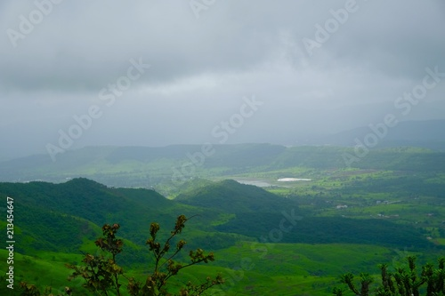 Foto op Canvas Bleke violet Green landscape surrounded by hills, mountains in monsoon season