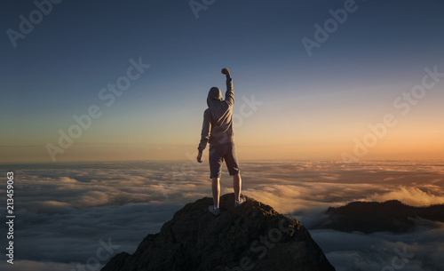 Keuken foto achterwand Canarische Eilanden On the top of the world. Man on top of the mountain above the clouds.