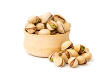 Pistachio Nuts In A Wooden Pla...