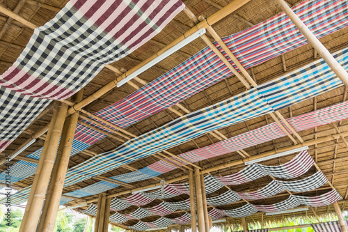 Fotografía Traditional loincloth (sarong) in Thailand decorate on bamboo beam in countryside