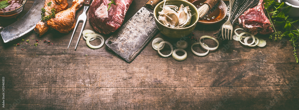 Fototapety, obrazy: Various grill and bbq meat : chicken legs, steaks, lamb ribs with vintage kitchenware kitchen utensils:  Meat Fork and Butcher Cleaver and herbs knife. Sauces and ingredients for grilling, top view