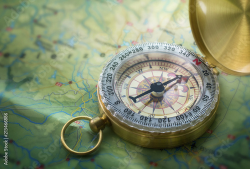 Fotobehang Wereldkaart Magnetic compass on world map.Travel, geography, navigation, tourism and exploration concept background. Macro photo. Very shallow focus.